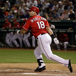 Texas Rangers' Mitch Moreland (18) follows through on a swing against the Cleveland Indians a baseball game Thursday, Sept. 13, 2012, in Arlington, Texas. The Indians won 5-4. (AP Photo/Tony …