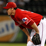 Texas Rangers' Joe Nathan leans over and looks toward the outfield at a Cleveland Indians' Carlos Santana double in the ninth inning of a baseball game Thursday, Sept. 13, 2012, in Arlington …