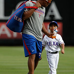 Texas Rangers' Adrian Beltre, left, shares a drink with his son Adrian Jr. after throwing batting practice to him before a baseball game against the Cleveland Indians, Thursday, Sept. 13, 20 …