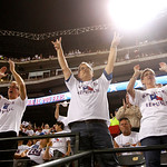 "Baseball fans put on shirts that read ""Rangers Republic,"" Thursday, Sept. 13, 2012, in Arlington, Texas, and cheer after an announcement was made during a baseball game against the Cleveland …"
