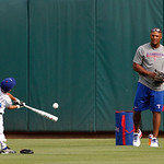 Texas Rangers' Adrian Beltre (29) throws batting practice to his son Adrian Jr., before a baseball game against the Cleveland Indians Thursday, Sept. 13, 2012, in Arlington, Texas. (AP Photo …