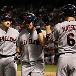 Cleveland Indians' Vinny Rottino, left, watches as Matt LaPorta, center, is congratulated on his two-run by Lou Marson (6) in the sixth inning of a baseball game Thursday, Sept. 13, 2012, in …