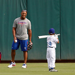 Texas Rangers' Adrian Beltre (29) smiles as he gets ready to throw batting practice to his son Adrian Jr. before a baseball game against the Cleveland Indians, Thursday, Sept. 13, 2012, in A …