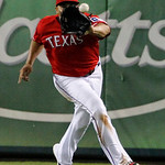Texas Rangers right fielder Nelson Cruz (17) reaches a fly-out by Cleveland Indians' Jason Kipnis in the fifth inning of a baseball game on Thursday, Sept. 13, 2012, in Arlington, Texas. (AP …