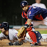 Minnesota Twins&#039; Darin Mastroianni, left, slides home to score past Cleveland Indians catcher Carlos Santana in the 12th inning of a baseball game, Tuesday, Sept. 18, 2012, in Cleveland. Mas &#8230;