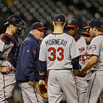 Minnesota Twins manager Ron Gardenhire talks with his infield in a baseball game against the Cleveland Indians Tuesday, Sept. 18, 2012, in Cleveland. (AP Photo/Mark Duncan)