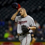 Minnesota Twins starting pitcher P.J. Walters rubs his head in a baseball game against the Cleveland Indians Tuesday, Sept. 18, 2012, in Cleveland. (AP Photo/Mark Duncan)