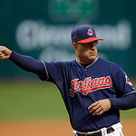 Cleveland Indians manager Manny Acta talks with the umpires before a baseball game against the Minnesota Twins Tuesday, Sept. 18, 2012, in Cleveland. (AP Photo/Mark Duncan)