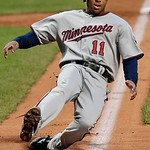 Minnesota Twins&#039; Ben Revere (11) slides home to score form third on a sacrifice fly by Justin Morneau in the first inning of a baseball game against the Cleveland Indians, Tuesday, Sept. 18, &#8230;