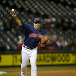 Cleveland Indians relief pitcher Cody Allen throws to first in a baseball game against the Minnesota Twins Tuesday, Sept. 18, 2012, in Cleveland. (AP Photo/Mark Duncan)