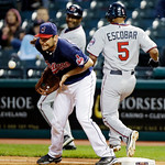 Minnesota Twins&#039; Eduardo Escobar (5) reaches first on an infield single as Cleveland Indians first baseman Casey Kotchman takes the throw in the second inning of a baseball game, Tuesday, Se &#8230;