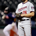 Minnesota Twins relief pitcher Glen Perkins stands on the mound after giving up a solo home run to Cleveland Indians&#039; Carlos Santana in the 12th inning of a baseball game, Tuesday, Sept. 18, &#8230;