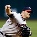 Minnesota Twins starting pitcher P.J. Walters delivers against the Cleveland Indians in the first inning of a baseball game, Tuesday, Sept. 18, 2012, in Cleveland. (AP Photo/Mark Duncan)