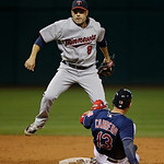 Minnesota Twins second baseman Jamey Carroll (8) avoids Cleveland Indians&#039; Asdrubal Cabrera (13) in a baseball game Tuesday, Sept. 18, 2012, in Cleveland. (AP Photo/Mark Duncan)