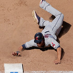 Cleveland Indians' Michael Brantley beats the tag by Kansas City Royals shortstop Alcides Escobar as he dives back to first after being caught off-base during the sixth inning of a baseball  …