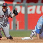 Kansas City Royals' Jeff Francoeur, right, is caught stealing second by Cleveland Indians second baseman Jason Kipnis during the second inning of a baseball game on Sunday, Sept. 23, 2012, i …