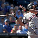 Cleveland Indians' Carlos Santana hits an RBI-single during the seventh inning of a baseball game against the Kansas City Royals, Sunday, Sept. 23, 2012, in Kansas City, Mo. (AP Photo/Charli …
