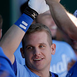 Kansas City Royals' Adam Moore celebrates in the dugout after hitting a solo home run during the third inning of a baseball game against the Cleveland Indians, Sunday, Sept. 23, 2012, in Kan …