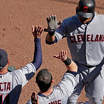 Cleveland Indians' Carlos Santana, right, celebrates as he comes into the dugout after hitting a two-run home run during the sixth inning of a baseball game against the Kansas City Royals, S …
