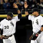 Chicago White Sox's Alejandro De Aza, left, and Alex Rios congratulate each other after the Sox defeated the Cleveland Indians 5-4 on Monday, Sept. 24, 2012, in Chicago. (AP Photo/John Smier …