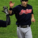 Cleveland Indians' Jason Kipris gets high-fives after scoring against the Chicago White Sox on a double by Asdrubal Cabrera in the third inning during a baseball game, Monday, Sept. 24, 2012 …