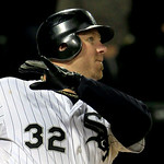 Chicago White Sox's Adam Dunn watches his three-run homer against the Cleveland Indians head for the wall during the eighth inning of a baseball game, Monday, Sept. 24, 2012, in Chicago. (AP …