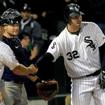 Chicago White Sox's Adam Dunn, right, gets congratulated at home plate by teammate Kevin Youkilis after Dunn hit a three-run homer against the Cleveland Indians during a baseball on Monday,  …