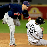 Chicago White Sox's A.J. Pierzynski is out at second on a fielder's choice as Cleveland Indian's Asdrubal Cabrera, left, makes the tag in the fifth inning of a baseball game, Monday, Sept. 2 …
