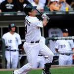 Chicago White Sox&#039;s Paul Konerko hits a solo home run against the Cleveland Indians during the ninth inning of a baseball game, Tuesday, Sept. 25, 2012, in Chicago. (AP Photo/John Smierciak)