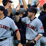 Cleveland Indian&#039;s Jason Kipnis high-fives teammates after they defeated the Chicago White Sox 4-3 in a baseball game, Tuesday, Sept. 25, 2012, in Chicago. (AP Photo/John Smierciak)