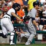 Detroit Tigers catcher Alex Avila (13) tags Cleveland Indians' Brent Lillibridge (1) out in a rundown on his way back to third base in the ninth inning of a baseball game in Detroit, Monday, …