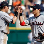 Cleveland Indians shortstop Asdrubal Cabrera (13) and right fielder Shin-Soo Choo, of South Korea, celebrate after defeating the Detroit Tigers 3-2 in a baseball game in Detroit, Monday, Sep …