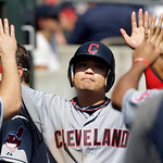 Cleveland Indians right fielder Shin-Soo Choo is congratulated after scoring on a Asdrubal Cabrera RBI single against the Detroit Tigers in the third inning of a baseball game in Detroit, Mo …