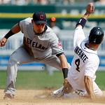 Cleveland Indians shortstop Asdrubal Cabrera, left, tags out Detroit Tigers' Omar Infante (4) on his attempt to steal second base in the seventh inning of a baseball game in Detroit, Monday, …