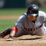 Cleveland Indians' Shin-Soo Choo, of South Korea, dives back into first base safely on an attempted pick off against the Detroit Tigers in the third inning of a baseball game in Detroit, Mon …