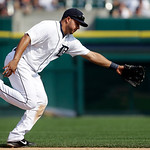 Detroit Tigers shortstop Jhonny Peralta cannot reach a ground ball by Cleveland Indians' Brent Lillibridge for a single in the ninth inning of a baseball game in Detroit, Monday, Sept. 3, 20 …