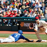 Cleveland Indians first baseman Casey Kotchman, right, catches the ball as Kansas City Royals' Jarrod Dyson slides back into first base in a baseball game, Sunday, Sept. 30, 2012, in Clevela …