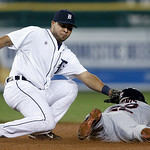 Detroit Tigers shortstop Jhonny Peralta tags out Cleveland Indians' on an attemped steal in the ninth inning of a baseball game in Detroit, Tuesday, Sept. 4, 2012. (AP Photo/Paul Sancya)