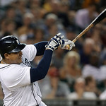Detroit Tigers' Miguel Cabrera swings on a two-run home run against the Cleveland Indians in the sixth inning of a baseball game in Detroit, Tuesday, Sept. 4, 2012. (AP Photo/Paul Sancya)