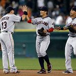Cleveland Indians' Asdrubal Cabrera, left, Shin-Soo Choo, of South Korea, and Michael Brantley, right, celebrate after the Indians defeated the Detroit Tigers 3-2 in a baseball game in Detro …