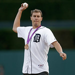 Olympic bronze medal swimmer Peter Vanderkaay throws a ceremonial pitch before the Detroit Tigers-Cleveland Indians baseball game in Detroit, Tuesday, Sept. 4, 2012. (AP Photo/Paul Sancya)