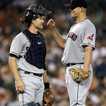 Cleveland Indians catcher Lou Marson, left, smiles with starting pitcher Justin Masterson on the mound during the sixth inning of a baseball game against the Detroit Tigers in Detroit, Tuesd …