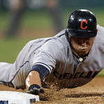 Cleveland Indians' Asdrubal Cabrera dives safely into first base on a pick-off attempt by the Detroit Tigers in the fifth inning of a baseball game in Detroit, Tuesday, Sept. 4, 2012. (AP Ph …