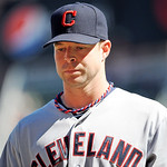 Cleveland Indians pitcher Corey Kluber walks off the field against the Minnesota Twins during their baseball game in Minneapolis, Sunday, Sept. 9, 2012. (AP Photo/Craig Lassig)