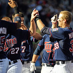 Minnesota Twins' Justin Morneau, right, celebrates his walkoff home run against the Cleveland Indians in the ninth inning of a baseball game in Minneapolis, Sunday, Sept. 9, 2012. The Twins  …