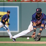 Minnesota Twins shortstop Pedro Florimon grabs a ground ball against the Cleveland Indians during their baseball game in Minneapolis, Sunday, Sept. 9, 2012. (AP Photo/Craig Lassig)