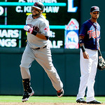 Cleveland Indians first baseman Carlos Santana, left, rounds the bases after hitting a home run as Minnesota Twins shortstop Pedro Florimon, right, watches in the the second inning of their  …