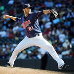 Minnesota Twins pitcher Jared Burton throws against the Cleveland Indians during their baseball game in Minneapolis, Sunday, Sept. 9, 2012. (AP Photo/Craig Lassig)