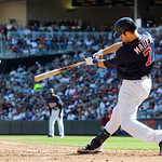 Minnesota Twins designated hitter Joe Mauer hits a triple against Cleveland Indians pitcher Corey Kluber, driving in a run, in the third inning of their baseball game in Minneapolis, Sunday, …