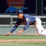 Minnesota Twins center fielder Ben Revere, attempts to steal third against the Cleveland Indians  during their baseball game in Minneapolis, Sunday, Sept. 9, 2012. (AP Photo/Craig Lassig)
